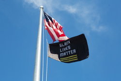 Flag pole with US flag and Black Lives Matter flag. Photo: Burlington (VT) School District